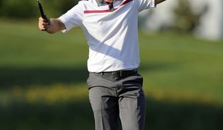 Justin Rose, of England, reacts after winning the Quicken Loans National PGA golf tournament in a playoff round against Shawn Stefani, Sunday, June 29, 2014, in Bethesda, Md. (AP Photo/Nick Wass)