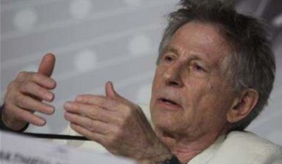 Director Roman Polanski speaks during a press conference for Venus in Fur at the 66th international film festival, in Cannes, southern France, Saturday, May 25, 2013. (AP Photo/Virginia Mayo)