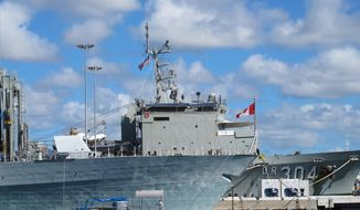 A Canadian ship sits docked at Pearl Harbor, Hawaii, during the the Rim of the Pacific naval exercises on Monday, June 30, 2014. (AP Photo/Audrey McAvoy)