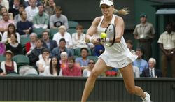 Eugenie Bouchard of Canada plays a return to Alize Cornet of France during their women's singles match at the All England Lawn Tennis Championships in Wimbledon, London, Monday, June 30, 2014. (AP Photo/Pavel Golovkin)