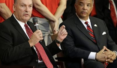 **FILE** Big Ten Commissioner James Delany, left, speaks at a news conference to announce the University of Maryland's decision to move to the Big Ten in College Park, Md., Monday, Nov. 19, 2012. Seated alongside Delany is Maryland athletic director Kevin Anderson.  (AP Photo/Patrick Semansky)