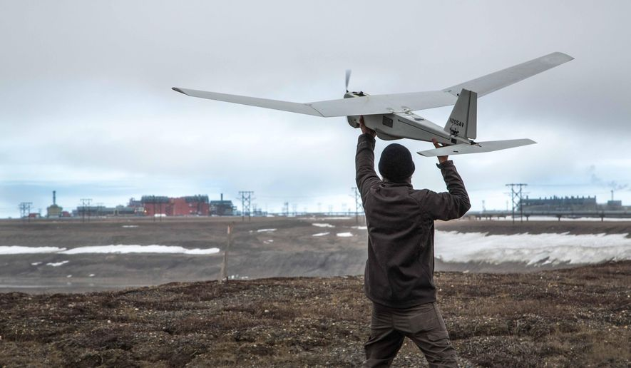 In this photo June 7, 2014, photo released by BP Alaska, Unmanned Aerial System (UAS) technology using an AeroVironment Puma drone is given a pre-flight checkout in preparation for flights by BP at its Prudhoe Bay, Alaska operations. The Federal Aviation Administration granted the first permission for commercial drone flights over land, the latest effort by the agency to show it is loosening restrictions on commercial uses of the unmanned aircraft.  The federal effort to provide drones regular access to U.S. skies faces significant hurdles and won't meet a September 2015 deadline set by Congress, said a report released June 30 by a government watchdog. A report by the Transportation Department's inspector general says the Federal Aviation Administration hasn't figured out what kind of technology unmanned aircraft should use to avoid crashing into other planes. (AP Photo/BP Alaska)