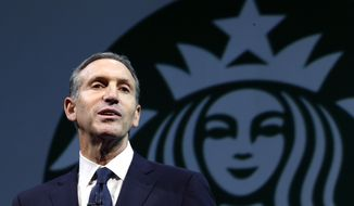 In this March 20, 2013 file photo, Starbucks CEO Howard Schultz speaks at the company's annual shareholders meeting, in Seattle, Wash. (AP Photo/Ted S. Warren, File)