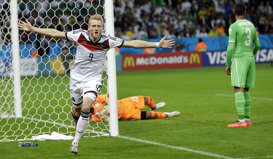 Germany's Andre Schuerrle celebrates after scoring the opening goal during the World Cup round of 16 soccer match between Germany and Algeria at the Estadio Beira-Rio in Porto Alegre, Brazil, Monday, June 30, 2014. (AP Photo/Sergei Grits)