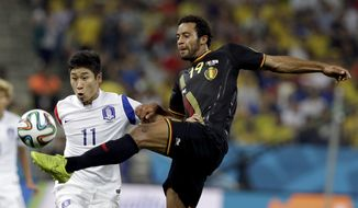 Belgium's Mousa Dembele clears the ball in front of South Korea's Lee Keun-ho during the group H World Cup soccer match between South Korea and Belgium at the Itaquerao Stadium in Sao Paulo, Brazil, Thursday, June 26, 2014. (AP Photo/Thanassis Stavrakis)