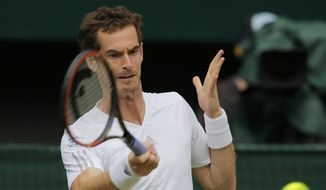 Andy Murray of Britain plays a return to Kevin Anderson of South Africa during their men's singles match at the All England Lawn Tennis Championships in Wimbledon, London, Monday, June 30, 2014. (AP Photo/Pavel Golovkin)
