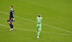 Germany's goalkeeper Manuel Neuer, left, walks past Algeria's Sofiane Feghouli after the World Cup round of 16 soccer match between Germany and Algeria at the Estadio Beira-Rio in Porto Alegre, Brazil, Monday, June 30, 2014. Germany beat Algeria 2-1 in extra time to set up World Cup quarterfinal match vs France. (AP Photo/Thanassis Stavrakis)