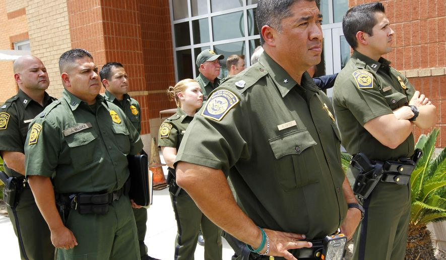 **FILE** U.S. Border Patrol Agents listen to U.S. Secretary of Homeland Security Jeh Johnson speak during a press conference in Edinburg, Texas, on June 30, 2014. Johnson said he is sending an additional 150 Border Patrol agents to the Rio Grande Valley Sector to help with a recent spike in immigrants crossing the border through the area. (Associated Press/The Monitor, Nathan Lambrecht)