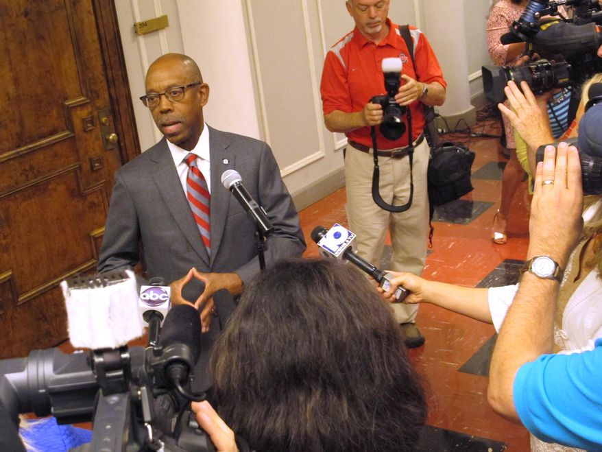 ** FILE ** Ohio State University President Michael Drake answers questions after arriving for his first day on the job, on Monday, June 30, 2014, in Columbus, Ohio. (AP Photo/Andrew Welsh-Huggins)