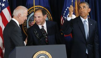 President Barack Obama givers a thumbs up to audience members seated above as he nominates former Procter and Gamble executive Robert McDonald, center, as the next Veterans Affairs secretary at the Department of Veterans Affairs in Washington, Monday, June 30, 2014. Vice President Joe Biden is at left. If confirmed by the Senate, McDonald would succeed Eric Shinseki, the retired four-star general who resigned last month as the scope of the issues at veterans' hospitals became apparent. (AP Photo/Charles Dharapak)