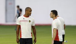 Belgium's captain Vincent Kompany, left, and Thomas Vermaelen, who are both recovering from injury, take part in a training session at Estadio Manoel Barradas, the day before the World Cup round of 16 soccer match between Belgium and USA at Arena Fonte Nova in Salvador, Brazil, Monday, June 30, 2014. (AP Photo/Matt Dunham)