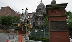 In this May 19, 2005, file photo, construction workers work on part of the Johns Hopkins Hospital in Baltimore. (AP Photo/Chris Gardner, File) ** FILE **