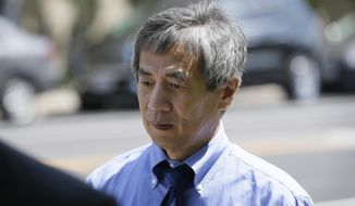 Former Iowa State University researcher Dong-Pyou Han leaves the Federal Courthouse, Tuesday, July 1, 2014, in Des Moines, Iowa. Han was making his initial court appearance on charges that he falsified data to make a proposed AIDS vaccine appear promising and win millions of dollars in federal grant money. (AP Photo/Charlie Neibergall)