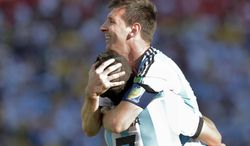 Argentina's Lionel Messi celebrates with Angel di Maria after di Maria scored his side's only and winning goal in extra time during the World Cup round of 16 soccer match between Argentina and Switzerland at the Itaquerao Stadium in Sao Paulo, Brazil, Tuesday, July 1, 2014. Argentina defeated Switzerland 1-0 to move on to the quarterfinals. (AP Photo/Manu Fernandez)