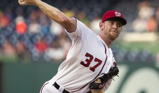 Washington Nationals starting pitcher Stephen Strasburg delivers a pitch to the Colorado Rockies during the first inning of a baseball game at Nationals Park, on Tuesday, July 1, 2014, in Washington. (AP Photo/ Evan Vucci)