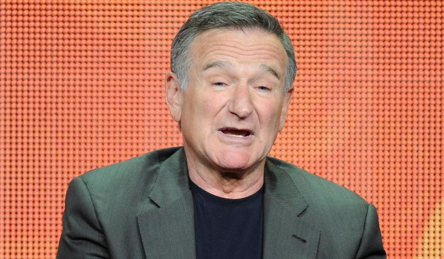 """FILE - In this July 29, 2013 file photo, actor Robin Williams participates in the """"The Crazy Ones"""" panel at the 2013 CBS Summer TCA Press Tour at the Beverly Hilton Hotel in Beverly Hills, Calif. Williams is reconnecting with the 12-step program during a brief stay in Minnesota. A spokeswoman for the 62-year-old actor-comedian said on Tuesday, July 1, 2014, that Williams planned the visit as a respite to recharge after more than 18 straight months of work.  (Photo by Frank Micelotta/Invision/AP, File)"""
