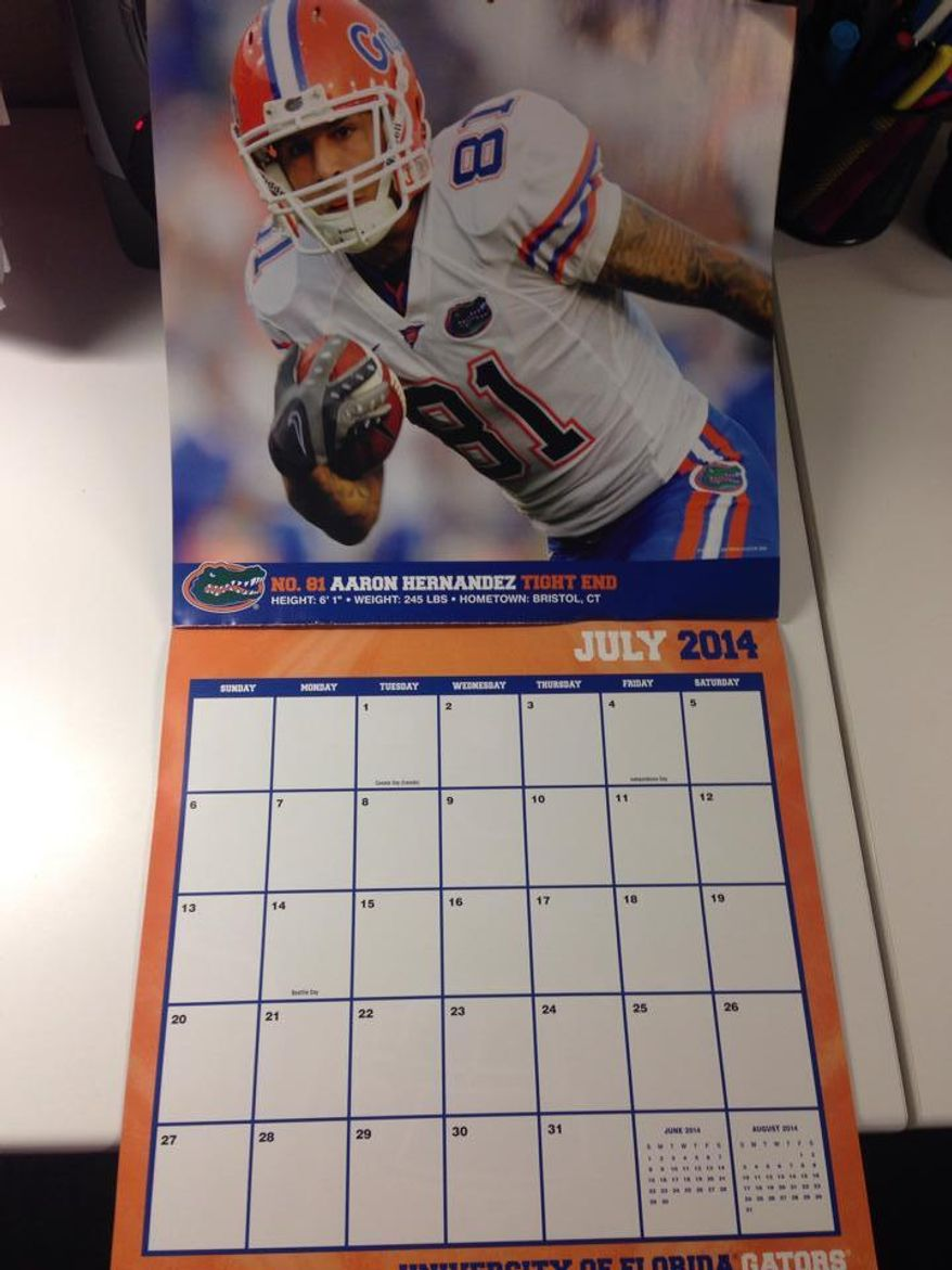 The University of Florida will not recall its 2014 sports calendar, which features a spread of Aaron Hernandez for the month of July, explaining that the calendar was approved before the former football star was charged in the murder of three men. (Jimi Kunkel via Twitter)