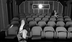 """This June 13, 1984 photo released by Magnolia Pictures shows film critics Roger Ebert, left, and Gene Siskel in screening room for photo shoot in Chicago, used in the documentary """"Life Itself."""" (AP Photo/Magnolia Pictures, Kevin Horan)"""