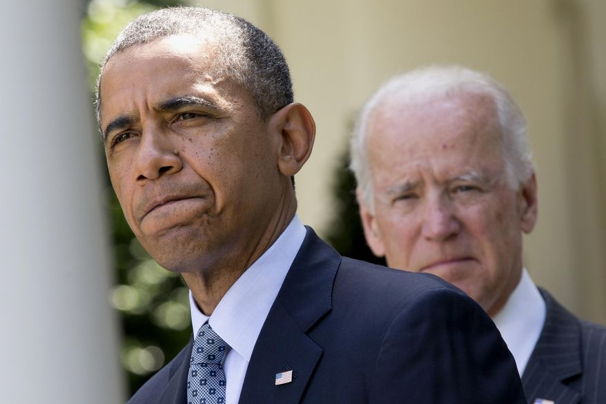 President Barack Obama, accompanied by Vice President Joe Biden, pauses while making an announcement about immigration reform, Monday, June 30, 2014, in the Rose Garden of the White House in Washington. (AP Photo/Jacquelyn Martin)