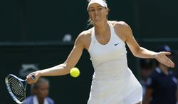 Maria Sharapova of Russia returns to Angelique Kerber of Germany during their women's singles match at the All England Lawn Tennis Championships in Wimbledon, London, Tuesday, July 1, 2014. (AP Photo/Ben Curtis)