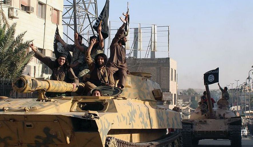 This undated image posted by the Raqqa Media Center, a Syrian opposition group, on Monday, June 30, 2014, which has been verified and is consistent with other AP reporting, shows fighters from the al Qaeda linked Islamic State of Iraq and the Levant (ISIL) during a parade in Raqqa, Syria. (AP Photo/Raqqa Media Center)