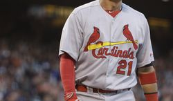 St. Louis Cardinals' Allen Craig walks back to the dugout after being struck out with the bases loaded by San Francisco Giants starting pitcher Tim Lincecum in the fourth inning of a baseball game Tuesday, July 1, 2014, in San Francisco. (AP Photo/Eric Risberg)