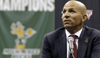 Jason Kidd speaks at a press conference after being introduced as the new head NBA basketball coach of the Milwaukee Bucks, Wednesday, July 2, 2014, in Milwaukee. (AP Photo/Jeffrey Phelps)