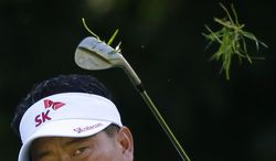 K.J. Choi chips onto the 13th green during the second round of the Quicken Loans National PGA golf tournament, Friday, June 27, 2014, in Bethesda, Md. (AP Photo/Patrick Semansky)