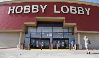 ** FILE ** In this Monday, June 30, 2014, file photo, customers walk to a Hobby Lobby store in Oklahoma City. (AP Photo/Sue Ogrocki, File)