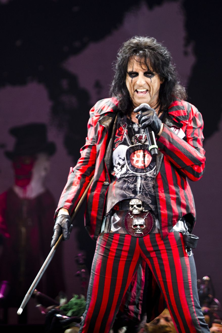 Alice Cooper opens for Motley Crue in a concert at Van Andel Arena in Grand Rapids, Mich., Wednesday, July 2, 2014. (AP Photo/Grand Rapids Press, Joel Bissell)