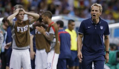 United States' head coach Juergen Klinsmann shouts out during the World Cup round of 16 soccer match between Belgium and the USA at the Arena Fonte Nova in Salvador, Brazil, Tuesday, July 1, 2014. (AP Photo/Matt Dunham)