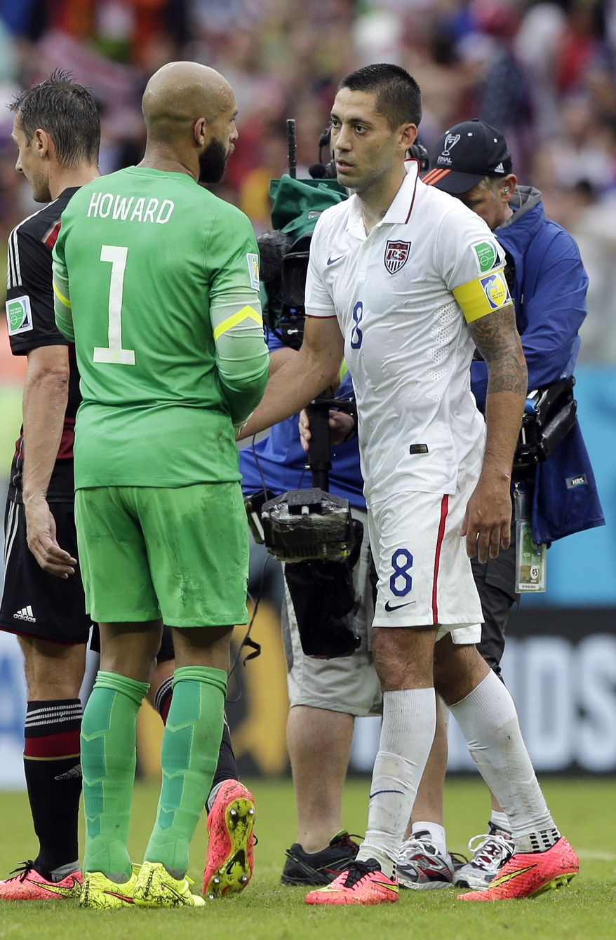 United States' goalkeeper Tim Howard, left, shakes hands with Clint Dempsey after the group G World Cup soccer match between the USA and Germany at the Arena Pernambuco in Recife, Brazil, Thursday, June 26, 2014. (AP Photo/Matthias Schrader)