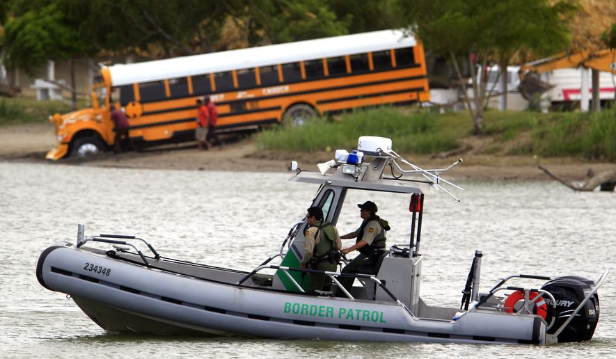 A U.S. Border Patrol boat secures the area as U.S. Customs and Border Protection Commissioner Gil Kerlikowske, not pictured, talks about the dangers of crossing the U.S. border during a news conference for a Danger Awareness Campaign at Anzalduas Park next to the Rio Grande River in Mission, Texas on Wednesday July 2, 2014. The campaign is a Spanish-language outreach effort aimed at highlighting the risks and undercutting the perceived rewards of illegal immigration. (AP Photo/The Monitor, Gabe Hernandez)