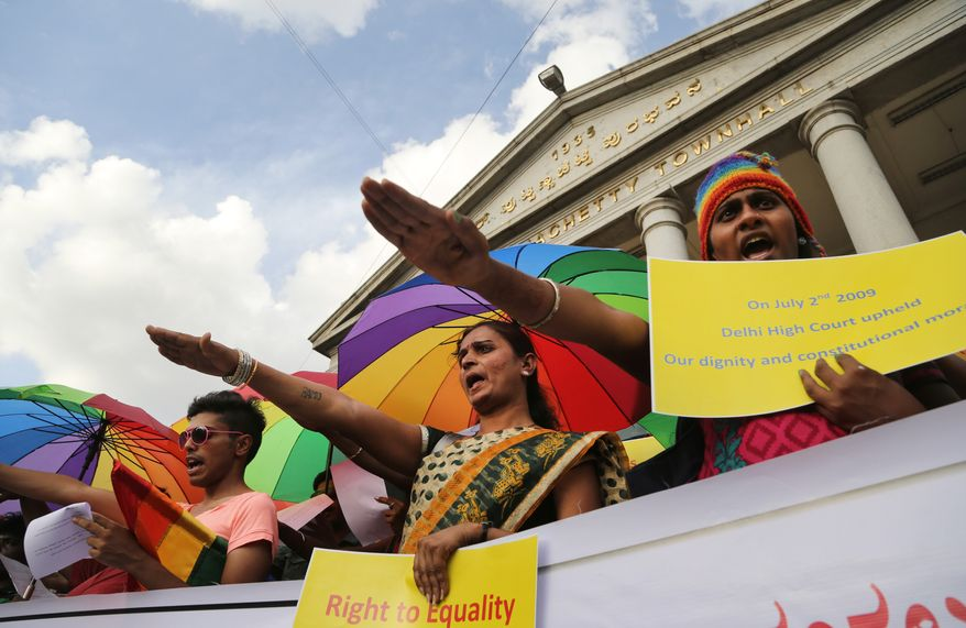 Gay-rights activists take oath to fight against inequality during a celebration marking the fifth anniversary of an Indian court's ruling decriminalizing homosexuality in India, in Bangalore, India, Wednesday, July 2, 2014. (AP Photo/Aijaz Rahi)