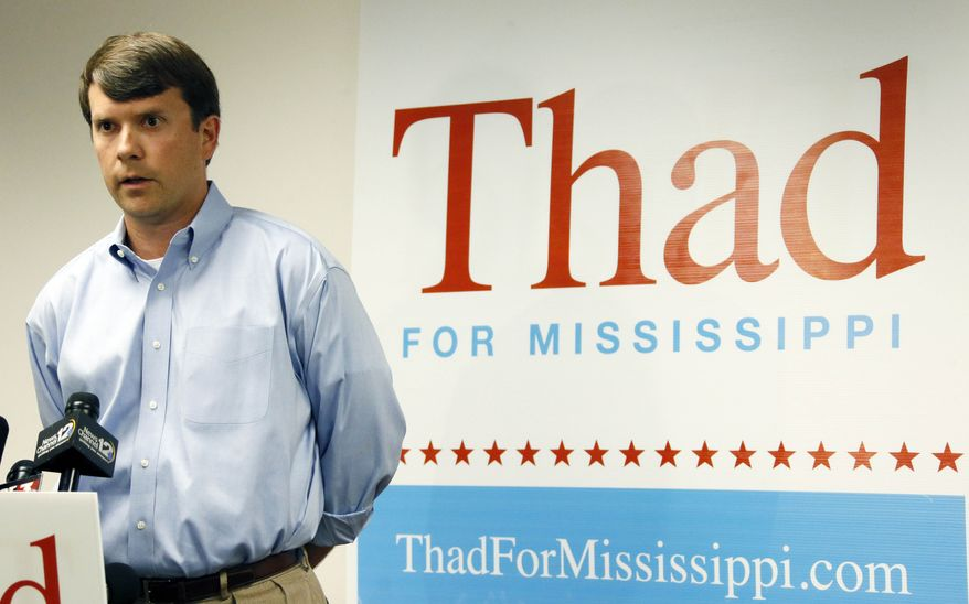 """Austin Barbour, a senior advisor with U.S. Sen. Thad Cochran's reelection campaign responds to the voting irregularities allegations made by state Sen. Chris McDaniel, R-Ellisville, and a number of his supporters, at a news conference in Jackson, Miss., Wednesday, July 2, 2014.   Barbour challenged McDaniel and his supporters to go """"put up or shut up,"""" with evidence to prove the allegations of illegal voting. (AP Photo/Rogelio V. Solis)"""