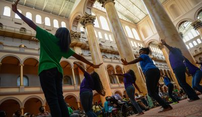 Washington Performing Arts Society Children of the Gospel Choir perform a dance routine as they sing gospel music at the National Building Museum, Washington, D.C., Sunday, August 4, 2013. (Andrew Harnik/The Washington Times)