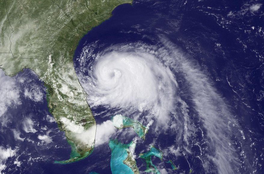 This Wednesday, July 2, 2014, satellite image taken at 3:35 p.m. EDT and released by the National Oceanic and Atmospheric Administration (NOAA), shows Tropical Storm Arthur moving north off the east coast of Florida. The first named storm of the Atlantic hurricane season has strengthened to a hurricane early Thursday, July 3, 2014, and threatened to give North Carolina a glancing blow on Independence Day, prompting the governor to warn vacationers along the coast not to risk their safety by trying to salvage their picnics and barbecues. (AP Photo/NOAA)