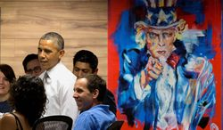 """President Barack Obama stands next to a painting of """"Uncle Sam,"""" during a visit with workers at 1776, a hub for tech startups, Thursday, July 3, 2014, in Washington. The president said  job growth in June shows the recovery is taking hold, but the economy could still do better, he also urged Congress to work with him to help create more jobs.  (AP Photo/Jacquelyn Martin)"""