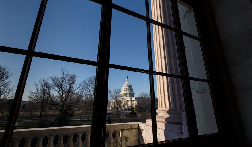 The Capitol is seen from the Russell Senate Office Building. While crises mount abroad and at home, some candidates this year are betting that a big issue for voters will be free gym use and subsidized haircuts on Capitol Hill. (AP Photo/J. Scott Applewhite)