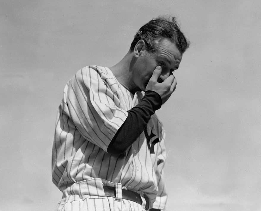 Pouring it on for Lou Gehrig and others. (AP Photo/Murray Becker)