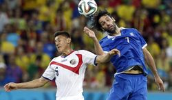 Costa Rica's Celso Borges, left, and Greece's Giorgos Samaras battle for the ball during the World Cup round of 16 soccer match between Costa Rica and Greece at the Arena Pernambuco in Recife, Brazil, Sunday, June 29, 2014. (AP Photo/Ricardo Mazalan)