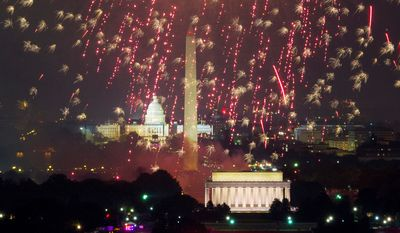 Washington D.C. fireworks can be seen from the Top of the Town as they explode over the National Mall to celebrate Independence Day. (Andrew Harnik/The Washington Times)