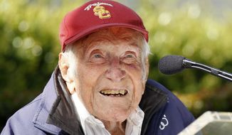 FILE - In a Friday May 9, 2014 file photo, Louis Zamperini gestures during a news conference, in Pasadena, Calif. Zamperini, a U.S. Olympic distance runner and World War II veteran who survived 47 days on a raft in the Pacific after his bomber crashed, then endured two years in Japanese prison camps, died Wednesday, July 2, 2014, according to Universal Pictures studio spokesman Michael Moses. He was 97. (AP Photo/Nick Ut, File)
