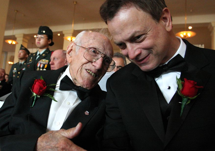 """FILE - In this May 10, 2008 file photo provided by the National Ethnic Coalition, 91-year-old World War II veteran and member of the U.S. Olympic team during the 1936 Berlin Olympics Louis Zamperini, left, shares a moment with actor and founder of """"Operation Iraqi Children"""" Gary Sinise before the start of the 2008 Ellis Island Medals of Honor ceremony on Ellis Island. Zamperini, a U.S. Olympic distance runner and World War II veteran who survived 47 days on a raft in the Pacific after his bomber crashed, then endured two years in Japanese prison camps, died Wednesday, July 2, 2014, according to Universal Pictures studio spokesman Michael Moses. He was 97.  (AP Photo/National Ethnic Coalition, Tina Fineberg, File)"""