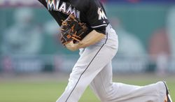 Miami Marlins starting pitcher Nathan Eovaldi delivers in the second inning of a baseball game against the St. Louis Cardinals, Friday, July 4, 2014, in St. Louis.(AP Photo/Tom Gannam)