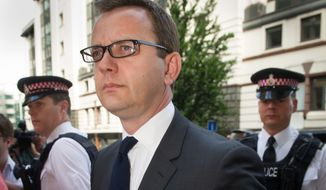 Former News of the World editor Andy Coulson arrives at the Old Bailey court to be sentenced,  in London,  Friday, July 4, 2014. Coulson, 46, has been found guilty of being involved in the conspiracy to hack into the phone voicemails of many celebrities, royals, politicians and ordinary members of the public, at the now-closed British Sunday tabloid newspaper. Coulson has been sentenced to 18 months in jail. (AP Photo/PA, Stefan Rousseau) UNITED KINGDOM OUT NO SALES NO ARCHIVE