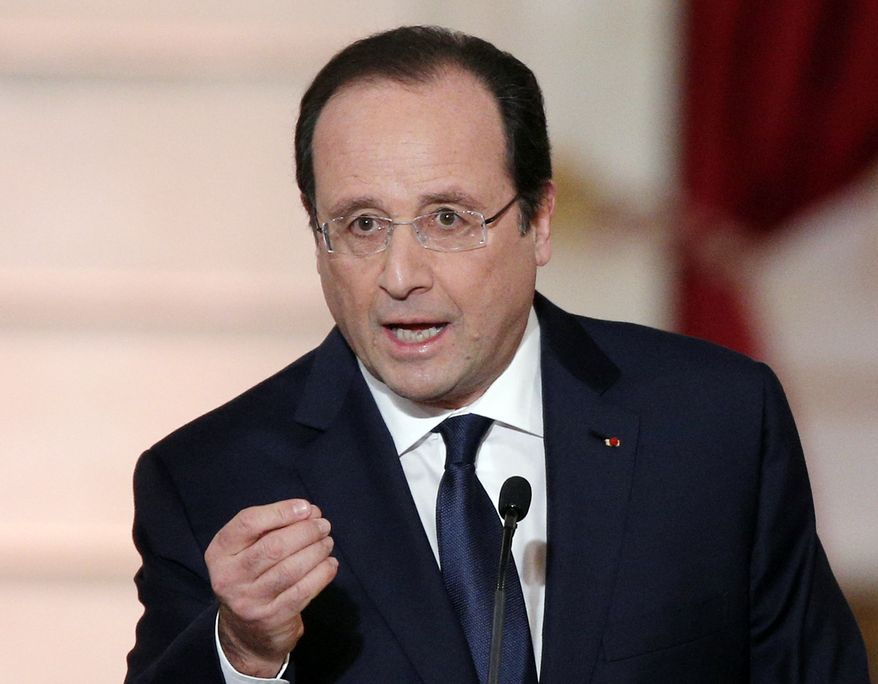 """** FILE ** In this Tuesday, Jan. 14, 2014, file photo, French President Francois Hollande delivers his speech at his annual news conference, at the Elysee Palace in Paris. Authorities say the mother of a pupil at a French preschool stabbed a teacher to death in front of her class Friday, July 4, 2014, the last day of the school year. Hollande expressed outrage at """"this abominable drama"""" at the Edouard Herriot school in Albi in southern France. (AP Photo/Christophe Ena, File)"""