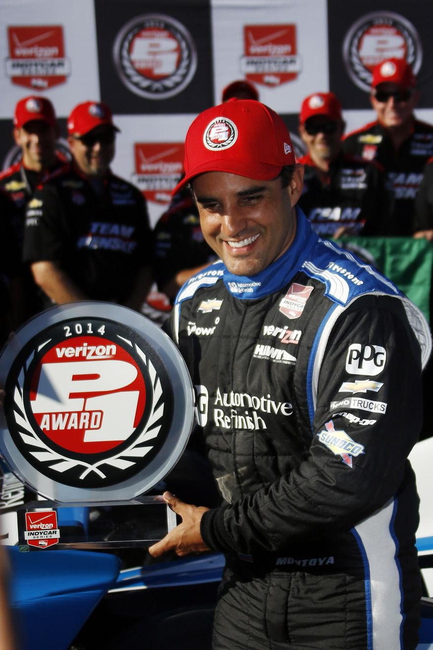 IndyCar driver Juan Pablo Montoya, of Colombia, poses with the pole award after qualifying in the first position for Sunday's Pocono IndyCar 500 auto race, Saturday, July 5, 2014, in Long Pond, Pa. (AP Photo/Matt Slocum)