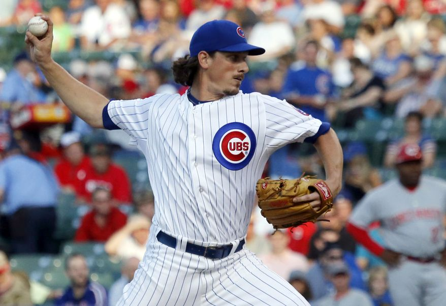 FILE - In this June 23, 2014, file photo, Chicago Cubs starting pitcher Jeff Samardzija delivers during the first inning of a baseball game against the Cincinnati Reds in Chicago. The Oakland Athletics have an agreement in place to acquire right-handers Jeff Samardzija and Jason Hammel from the Cubs for three top-line prospects in a surprising trade for baseball's top team, two people with knowledge of the deal said Friday night, July 4, 2014. (AP Photo/Charles Rex Arbogast, File)