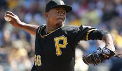 Pittsburgh Pirates starting pitcher Edinson Volquez  delivers during the first inning of a baseball game against the Philadelphia Phillies in Pittsburgh Saturday, July 5, 2014. (AP Photo/Gene J. Puskar)